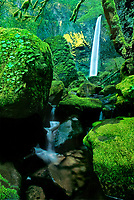 738600031 moss covered boulders frame elowah falls in the columbia river gorge national scenic area in northwest oregon