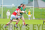 Paddy Kelly of John Mitchels breaks out of defence as Dingle's Daithi Graney and John Flannery challenge.   Copyright Kerry's Eye 2008