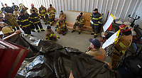 NWA Democrat-Gazette/ANDY SHUPE<br /> Fire captains, firefighters and training officers speak Wednesday, March 7, 2018, during a training workshop for fire department leadership to meet current National Fire Protection Association standards at the Fayetteville Fire Department training facility in south Fayetteville. Thirty students and instructors from agencies in seven states attended the training meant to train department training officers at current standards.