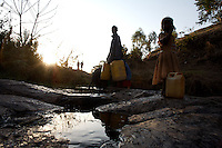 Meseret, 10 years old, fetches water from the main river of Shashamane, a village that hosts more than 300 Rastafarians Families, in Ethiopia on Wednesday March 19 2008.///..The Rastafarians, who are mainly from Jamaica, started migrating to Ethiopia 45 years ago, when Haile Selassie, whom they consider to be God incarnate, gave them 500 hectares of land on which to settle..Since the first 12 Jamaican settlers in 1963, the community has grown to over 200 families..The Rastafarian community insists that a mass exodus of Jamaicans to Ethiopia would not be a burden, despite the poverty and economic difficulties faced in the country..Some of them are skilled tradesmen such as carpenters and builders..Others are shop owners and they say that over the decades they have played an important role in the development of Shashamene..In January 2005 there were reports in the media that Bob marley's remains were to be exhumed and then reburied at Shashamane. His wife Rita Marley described Ethiopia as his spiritual home, provoking controversy in Jamaica, where his remains lie..At the beginning of the following month, thousands of fans gathered in Shashamane for a month of celebrations for what would have been Marley's 60th birthday. Until 2005 his birthday celebrations were always held in Jamaica. These events brought Shashamane to wider prominence throughout the world..