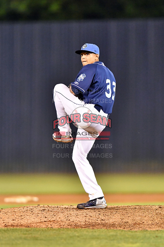 Asheville Tourists pitcher Justin Valdespina (33) delivers a pitch during a game against the Greensboro Grasshoppers  at McCormick Field on May 10, 2018 in Asheville, North Carolina. The Tourists defeated the Grasshoppers 9-3. (Tony Farlow/Four Seam Images)