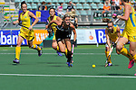 The Hague, Netherlands, June 09: Emily Smith #26 of Australia passes the ball during the field hockey group match (Women - Group A) between England and Argentina on June 9, 2014 during the World Cup 2014 at Kyocera Stadium in The Hague, Netherlands. Final score 0-0 (0-0)  (Photo by Dirk Markgraf / www.265-images.com) *** Local caption *** (L-R) Madonna Blyth #12 of Australia, Gemma Flynn #22 of New Zealand, Emily Smith #26 of Australia