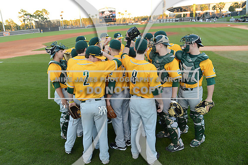 Siena Saints team huddle before warmups before the season opening game against the Central Florida Knights at Jay Bergman Field on February 14, 2014 in Orlando, Florida.  UCF defeated Siena 8-1.  (Copyright Mike Janes Photography)