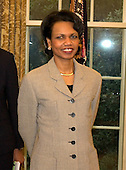 Doctor Condoleezza Rice, United States Secretary of State-designate stands behind  the President's desk in the Oval Office as United States President George W. Bush meets President Abdouaye Wade of the Republic of Senegal at the White House in Washington, D.C. on December 6, 2004.<br /> Credit: Ron Sachs / CNP.