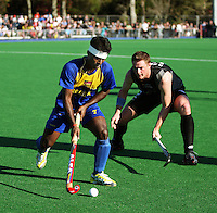 NZ's Steve Edwards pressures Selvaraju Sandrakasi during the international hockey match between the New Zealand Black Sticks and Malaysia at Fitzherbert Park, Palmerston North, New Zealand on Sunday, 9 August 2009. Photo: Dave Lintott / lintottphoto.co.nz