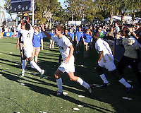 Darren Mattocks #11 of the University of Akron with the trophy during the 2010 College Cup final against the University of Louisville at Harder Stadium, on December 12 2010, in Santa Barbara, California.Akron champions, 1-0.