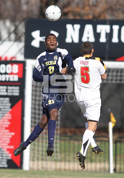 Doug Rodkey #5 of the University of Maryland is beaten to a header by Latif Alashe #21 of the University of Michigan during an NCAA quarter-final match at Ludwig Field, University of Maryland, College Park, Maryland on December 4 2010.Michigan won 3-2 AET.