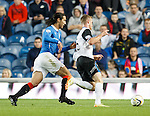 Bilel Mohsni caught dreaming by Marley Watkins who steals the ball from the Rangers defender