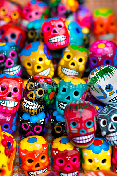Colorful painted skulls are sold on the market during the Day of the Dead celebrations in Mexico City, Mexico, 28 October 2016. Skulls, skeletons and the other death symbols are used to adorn graves, altars and offerings during the Day of the Dead (Día de Muertos). A syncretic religious holiday, combining the death veneration rituals of the ancient Aztec culture with the Catholic practice, is celebrated throughout all Mexico. Based on the belief that the souls of the departed may come back to this world on that day, people gather at the gravesites in cemeteries, praying, drinking and playing music, to joyfully remember friends or family members who have died and to support their souls on the spiritual journey.