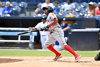 Lakewood BlueClaws Malvin Matos (33) swings at a pitch during a game against the Asheville Tourists at McCormick Field on August 4, 2019 in Asheville, North Carolina. The Tourists defeated the BlueClaws 13-6. (Tony Farlow/Four Seam Images)
