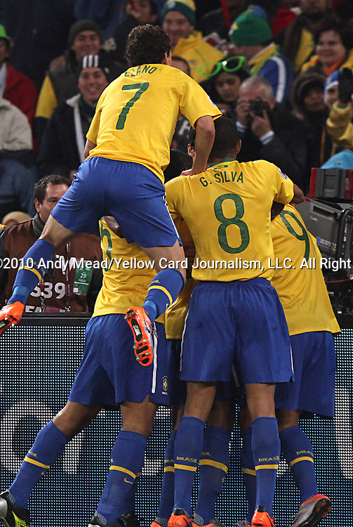 20 JUN 2010:  Elano (BRA)(7), Gilberto Silva (BRA)(8), Felipe Melo (BRA)(5), and Luis Fabiano (BRA)(9) celebrate Fabiano's second goal of the match.  The Brazil National Team defeated the C'ote d'Ivoire National Team 3-1 at the end of the first half at Soccer City Stadium in Johannesburg, South Africa in a 2010 FIFA World Cup Group G match.