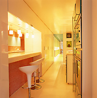 The corridor-style kitchen connects the living area at the front of the apartment with the sleeping and bathing areas at the back
