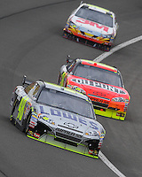 Feb 22, 2009; Fontana, CA, USA; NASCAR Sprint Cup Series driver Jimmie Johnson (48) leads Jeff Gordon (24) and Greg Biffle during the Auto Club 500 at Auto Club Speedway. Mandatory Credit: Mark J. Rebilas-