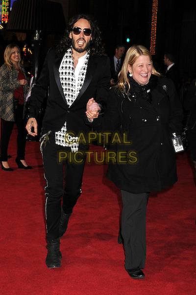 "Russell Brand & guest.""Gangster Squad"" Los Angeles Premiere held at Grauman's Chinese Theatre, Hollywood, California, USA..January 7th, 2013.full length trousers black grey gray white suit jacket coat sunglasses shades scarf top beard facial hair print .CAP/ADM/BP.©Byron Purvis/AdMedia/Capital Pictures."