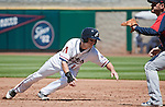 Reno Aces Evan Frey dives back into first in their game against the Tacoma Rainiers  played on Monday, May 7, 2012 in Reno, Nevada.