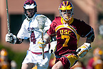 Los Angeles, CA 02/20/10 - Andrew Smulligan (USC # 7) and Evan Snively (LMU # 4) in action during the USC-Loyola Marymount University MCLA/SLC divisional game at Leavey Field (LMU).  LMU defeated USC 10-7.