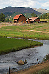Red-roof wooden barn; corrals, Swan Hereford Ranch, along the N. Fork, South Platte River in Colorado's Rocky Mountains.