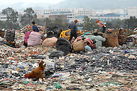 "The landfill of Tangxia in Guangdong Province, China. As well as some domestic waste the landfill mostly comprises of waste, such as offcuts discarded from shoe and textile factories discarded in the Tangxia area. Tangxia is a heavily polluted town and home of a factory  that makes trainers for the ""green"" and ""socially concious"" company Wornagain."