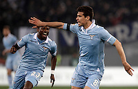 Calcio, Serie A: Roma vs Lazio. Roma, Stadio Olimpico, 8 aprile 2013..Lazio midfielder Hernanes, of Brazil, celebrates with teammate Ogenyi Onazi, of Nigeria, left, after scoring during the Italian serie A football match between A.S. Roma  and Lazio at Rome's Olympic stadium, 8 april 2013..UPDATE IMAGES PRESS/Isabella Bonotto