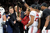 January 8th 2018, Atlanta, GA, USA; Alabama Crimson Tide head coach Nick Saban accepts the championship trophy after the College Football Playoff National Championship Game between the Alabama Crimson Tide and the Georgia Bulldogs on January 8, 2018 at Mercedes-Benz Stadium in Atlanta, GA.