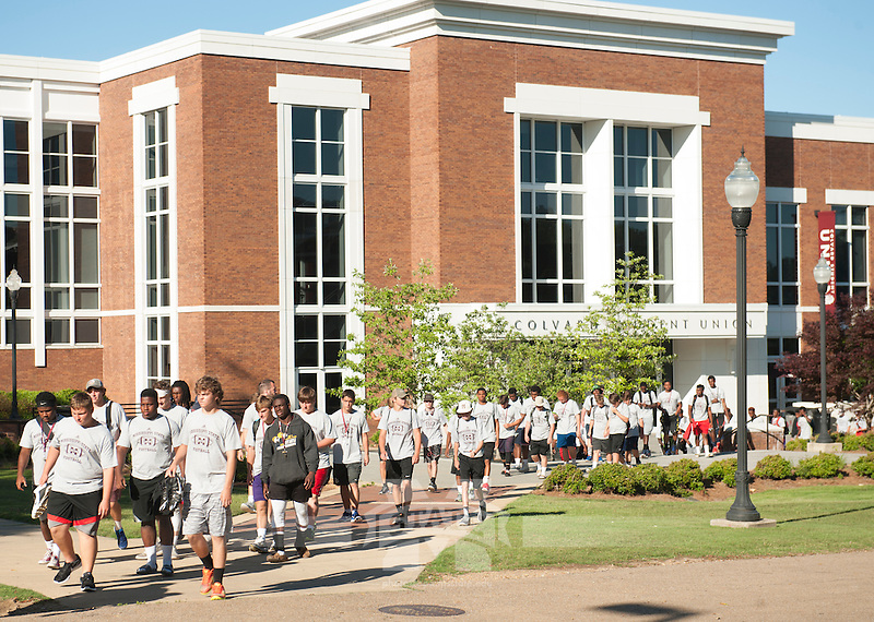 Students walking to practice at MSU Pre-college football camp<br />  (photo by Laura Smith Daniels / &copy; Mississippi State University)