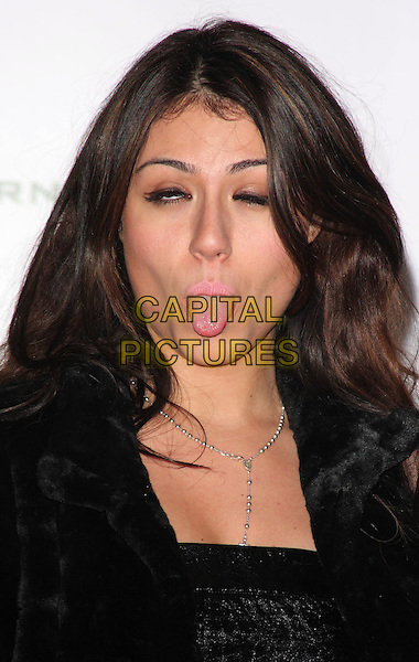 "GABRIELLA CILMI .""Call Of Duty - Modern Warfare 2"" Video Game Launch at the Vue Cinema, Leicester Square, London, England, November 9th 2009..portrait headshot funny face tongue sticking out black eyes blinking .CAP/ROS.©Steve Ross/Capital Pictures."