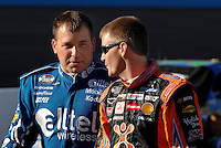 Apr 19, 2007; Avondale, AZ, USA; Nascar Nextel Cup Series driver Ryan Newman (12) talks with Jeff Burton (31) during qualifying for the Subway Fresh Fit 500 at Phoenix International Raceway. Mandatory Credit: Mark J. Rebilas
