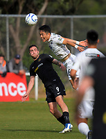Daewook Kim wins a header under pressure from Tom Jackson (9, Team Wellington) during the Oceania Football Championship final (second leg) football match between Team Wellington and Auckland City FC at David Farrington Park in Wellington, New Zealand on Sunday, 7 May 2017. Photo: Dave Lintott / lintottphoto.co.nz