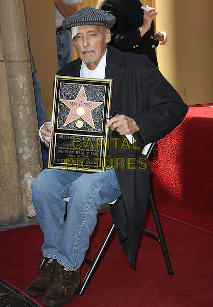 DENNIS HOPPER .Dennis Hopper is honored with the 2,403rd Star on the Hollywood Walk of Fame held On Hollywood Blvd., Hollywood, California , USA, 26th March 2010..full length holding frame sitting coat plaster injury injured on head forehead bandage  cap hat tweed grey gray white shirt beard facial hair goatee jeans brown trainers shoes .CAP/ADM/KB.©Kevan Brooks/AdMedia/Capital Pictures.