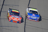 Sept. 28, 2008; Kansas City, KS, USA; Nascar Sprint Cup Series driver Jeff Gordon (24) races alongside Greg Biffle (16) during the Camping World RV 400 at Kansas Speedway. Mandatory Credit: Mark J. Rebilas-