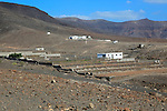 Group of houses in barren mountainous landscape, Jandia peninsula, Fuerteventura, Canary Islands, Spain