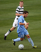 North Carolina's Ben Speas (17) beats Charlotte's Aidan Kirkbride (8) to score the lone goal of the game during the NCAA 2011 Men's College Cup in Hoover, AL on Sunday, December 11, 2011.