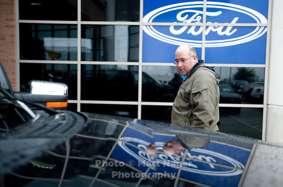 Chris Bailey (cq) checks out a new Ford F150 truck at Bankston Ford in Frisco, Texas, Thursday, Jan., 28, 2009. Ford reported gains in earnings for the first time in four years...PHOTOS/ Matt Nager