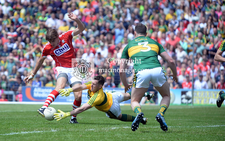 2-7-2017: Cork's Ian Maguire has his shot blocked by Kerryt keeper Brian Kelly at the Kerry V Cork Munster Football final in Killarney on Sunday.<br /> Photo: Don MacMonagle