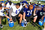 MAE GAMMINO/SPECIAL TO SCRIPPS TREASURE COAST NEWSPAPERS<br /> <br /> Players take a knee and give thanks at end of a long morning during the first day of practice for Sebastian River High School football,
