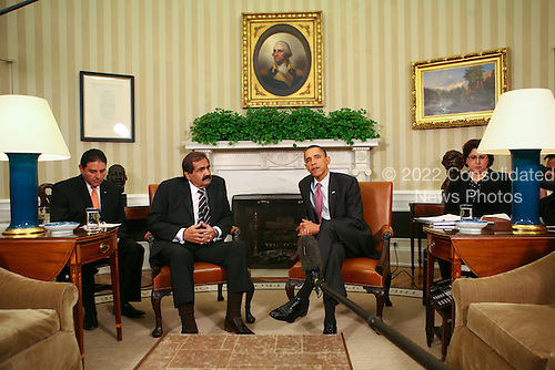 United States President Barack Obama meets with with Amir Hamad bin Khalifa al-Thani of Qatar in the Oval Office of the White House in Washington, D.C. on April 14, 2011.  .Credit: Gary Fabiano / Pool via CNP