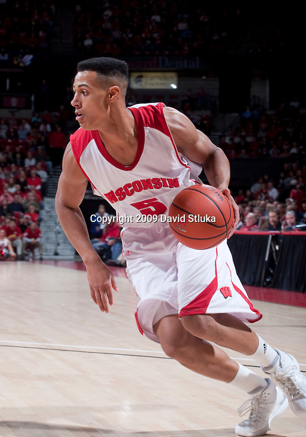 November 11, 2009: Wisconsin Badgers guard Ryan Evans (5) handles the ball during an NCAA basketball exhibition game against the UW-Superior Yellowjackets at the Kohl Center on November 11, 2009 in Madison, Wisconsin. The Badgers won 80-47. (Photo by David Stluka)