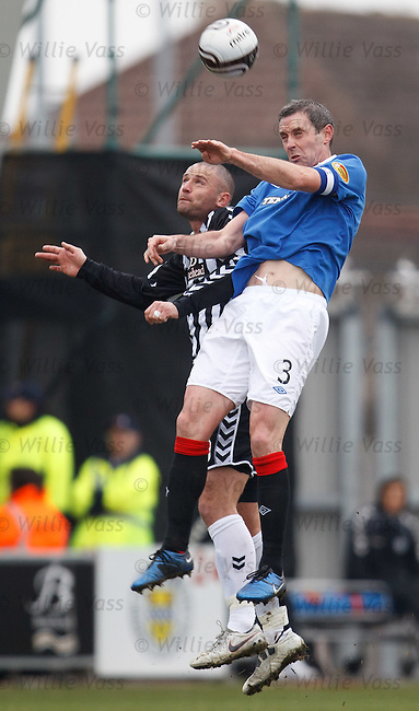 David Weir gets the better of Michael Higdon in the air