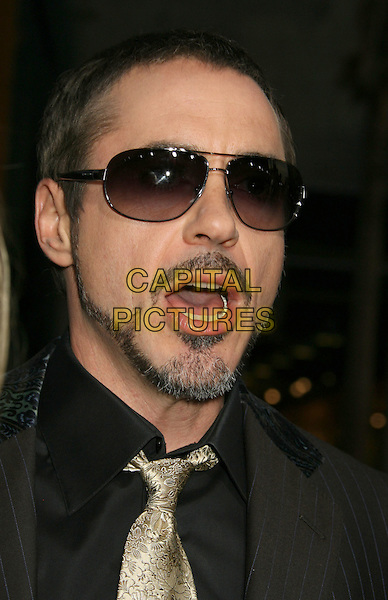 """ROBERT DOWNEY JR. .""""Iron Man"""" Los Angeles Premiere held at the Grauman's Chinese Theatre, Hollywood, California, USA,.30 April 2008..portrait headshot beard gold tie sunglasses mouth open funny.CAP/ADM/RE.©Russ Elliot/Admedia/Capital PIctures"""