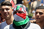"Palestinians take part during a demonstration against US policy supporting Israel and against ""Deal of the Century"" in the West Bank city of Ramallah on July 2, 2018. Photo by Shadi Hatem"