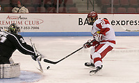 Boston, Massachusetts - January 23, 2016: NCAA Division I. Boston University (white/red) defeated Providence College (black), 5-1, at Agganis Arena.<br /> Scoring effort.