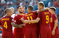 Calcio, Serie A: Roma vs Udinese. Roma, stadio Olimpico, 23 settembre 2017.<br /> Roma&rsquo;s Edin Dzeko, second from right, celebrates with teammates after scoring during the Italian Serie A football match between Roma and Udinese at Rome's Olympic stadium, 23 September 2017. Roma won 3-1.<br /> UPDATE IMAGES PRESS/Riccardo De Luca