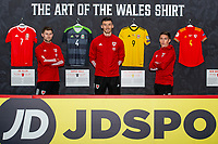 (L-R) Ben Davies, Kiefer Moore and Harry Wilson of Wales pose for a photo infront of the ' The art of the Wales shirt ' Exhibition at St Fagans National Museum of History in Cardiff, Wales, UK. Tuesday 12th November 2019