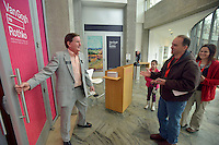 NWA Democrat-Gazette/BEN GOFF -- 02/23/15 Don Dragland of Bella Vista opens the door for guests Dan Ahnen, wife Dana Ahnen and daughter Laura Ahnen, 8, of Siloam Springs while volunteering at the new Van Gogh to Rothko exhibit at Crystal Bridges Museum of American Art in Bentonville on Monday Feb. 23, 2014.