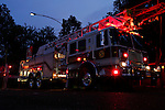 A Clifton Heights Fire Company ladder truck is setup with its emergency lights flashing
