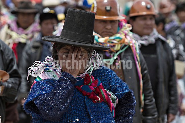 A picture dated Saturday January 26, 2013 shows a Quechua woman at the Miners Carnival in the Andes city of Potosi in Bolivia.  Already in 1663 the Spanish chronicler Marquez Jerez de los Caballeros described the colorful  miners carnival in Potosi. Four centuries later, the tradition of the legendary Cerro Rico miners is  still alive ..