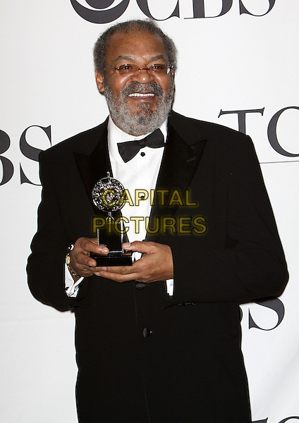 ROGER ROBINSON.63rd Annual Tony Awards Press Room held at Radio City Musical Hall, New York, NY, USA..June 7th, 2009.tonys pressroom award trophy half length white black tuxedo jacket bow tie beard facial hair glasses.CAP/ADM/PZ.©Paul Zimmerman/AdMedia/Capital Pictures.
