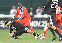 Jaime Moreno #99 of D.C. United stretches to get the ball away from Nana Attakora #3 and Jacob Peterson #23 of Toronto FC during an MLS match that was the final appearance of D.C. United's Jaime Moreno at RFK Stadium, in Washington D.C. on October 23, 2010. Toronto won 3-2.