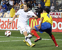 Heath Pearce #14 of the USA MNT moves the ball away from Juan Cuadrano #4 of Colombia during an international friendly match at PPL Park, on October 12 2010 in Chester, PA. The game ended in a 0-0 tie.