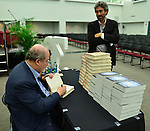 MIAMI, FL - SEPTEMBER 26: Author Salman Rushdie (L) and Mitchell Kaplan presents and sign copies of His new Book 'Joseph Anton: A Memoir' presented by Books and Books at Chapman Conference Center at Miami Dade College on September 26, 2013 in Miami, Florida. (Photo by Johnny Louis/jlnphotography.com)